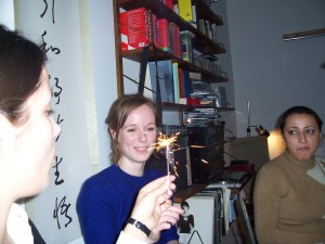 Danish tradition of passing around flaming objects right in front of paper wall-hangings