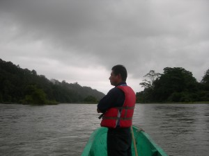 Indian guide on a rainy-ass river