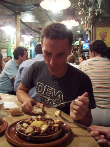 Attempting to stab the last life out of Galician octopus