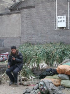 And think that a guy texting next to a vegetable pile sums up China pretty well these days